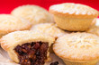 Sweet and spicy Christmas mince pies stacked on white plate. Clo