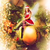 Fairy christmas woman on a decorative ball