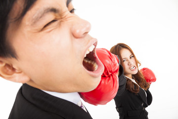 businesswoman hitting businessman isolated on white background