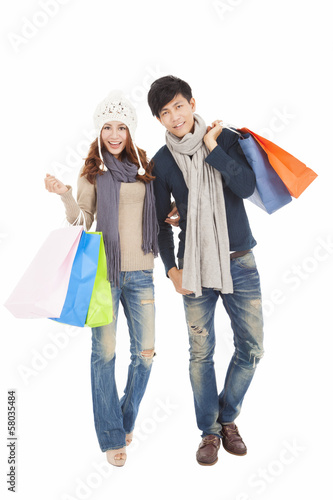 Happy couple doing shopping with winter clothing
