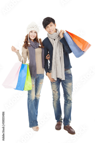 Happy couple doing shopping together