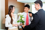 Asian Chinese hotel manager welcome VIP guests