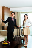 Asian Chinese hotel manager presenting suite