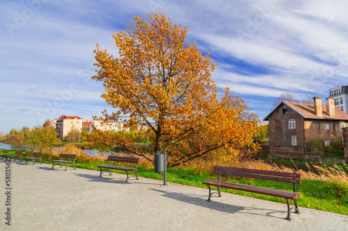 Autumnal square with benches in city center of Gdansk, Poland