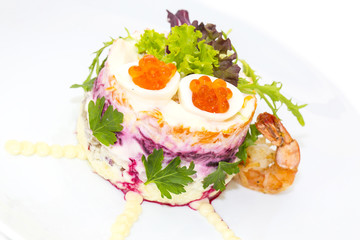 herring salad vegetables mayonnaise on a table in a restaurant
