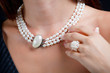 Woman with pearl necklace on her neck - 58036640