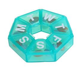 Green pill dispenser in the shape of a wheel