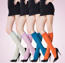 collection of colorful short stockings on sexy woman legs