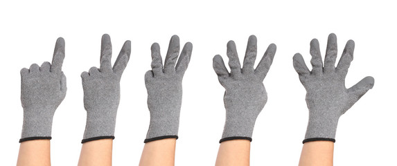 Hands in gloves show figures