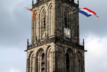 Martini tower with dutch flags in Groningen.The Netherlands