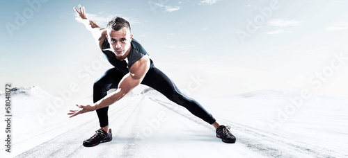 Triathlon runner man outdoor in winter snow landscape. Extreme f