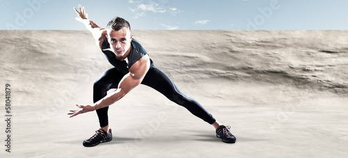 Triathlon runner man outdoor in urban concrete environment. Extr