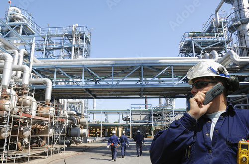 oil and gas workers inside large petrochemical industry