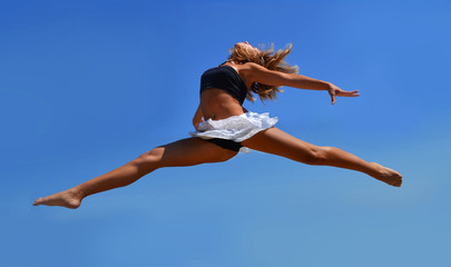 Dancing girl in a high jump
