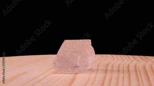 Crystal spiked raw mineral stone revolves on the board