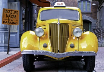 yellow vintage taxi