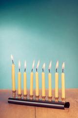 Hanukkah menorah with burning candles