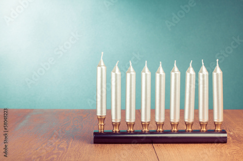 Hanukkah menorah with silver candles