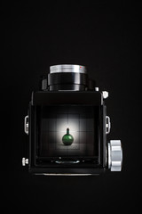 Photo shooting with vintage camera. Look through the viewfinder.