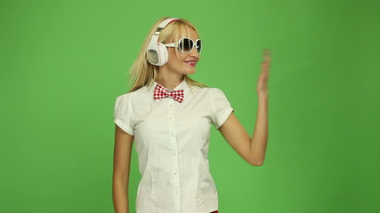 Beautiful blond woman wearing headphones