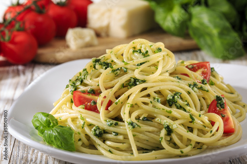 spaghetti with pesto and cherry tomatoes