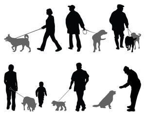 Silhouettes of people and dogs-vector