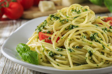 spaghetti with pesto and cherry tomatoes