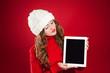 beautiful brunette girl  holding ipad