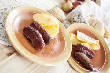 Salsicce di maiale e polenta