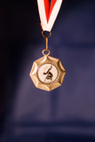 Medal with gymnast