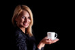 blond hair woman with coffe on a dark background