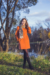Beautiful girl in an orange coat