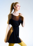 very beautiful woman posing in black dress - intentional motion