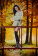 Young Caucasian sensual woman in a romantic autumn scenery