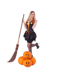 Halloween witch in  dress with pumpkin, broom