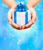 Fototapety Holiday background with hands holding gift boxes. Vector
