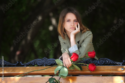 Young woman with a roses