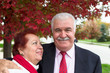 Senior Couple Portrait Under the Autumn Tree