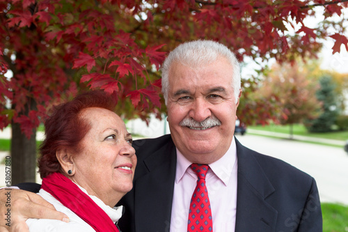 Senior Couple Portrait Under the Autumn Tree