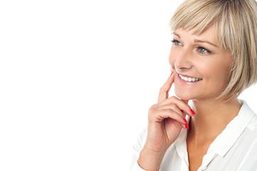 Smiling woman imagining something