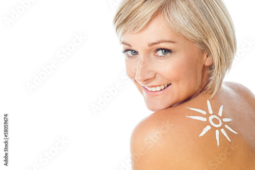 Lady with sun tan lotion on her back