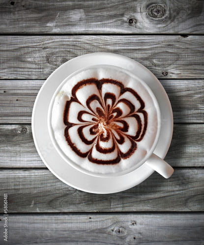 cup of coffee latte on  wood table background