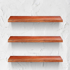 empty wooden shelf on white wall