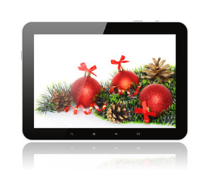 Tablet PC with Christmas decoration on white background.