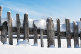 Old fence in the snow