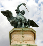 bronze statue of an Angel on top of the castle of Sant