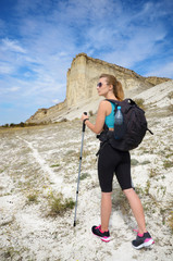 Young woman with backpack in mountains