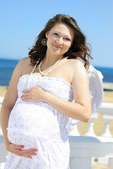 beautiful pregnant with a girl with wings