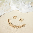 "Symbol ""smile"" on beach background"