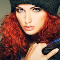 Beautiful redheaded girl in a sportwear, is in fashion style